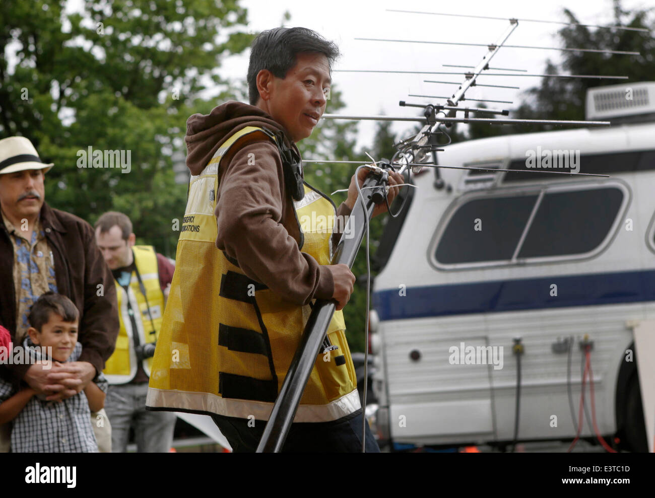 Vancouver, Canada. 28th June, 2014. An amateur radio operator adjusts the antenna angle for better signal reception Stock Photo