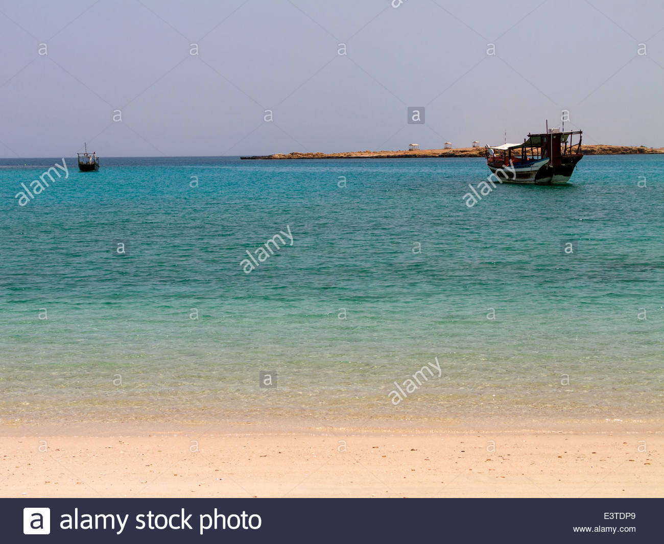 View of boats in calm sea - Oman - Stock Image