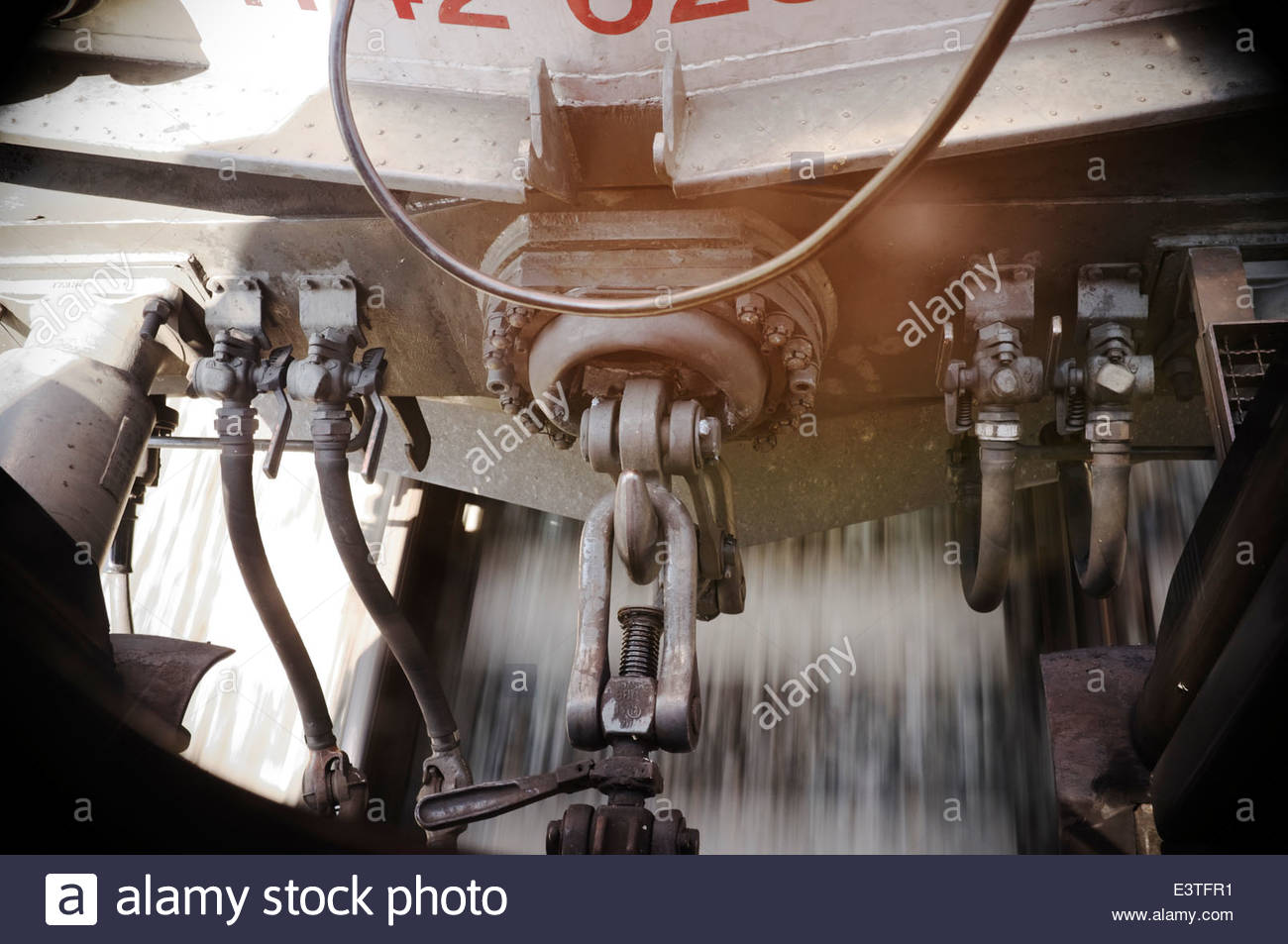 Railways - Buffer and chain coupler (or screw coupler), showing chain, towing hook, releasing screw and air brake - Stock Image