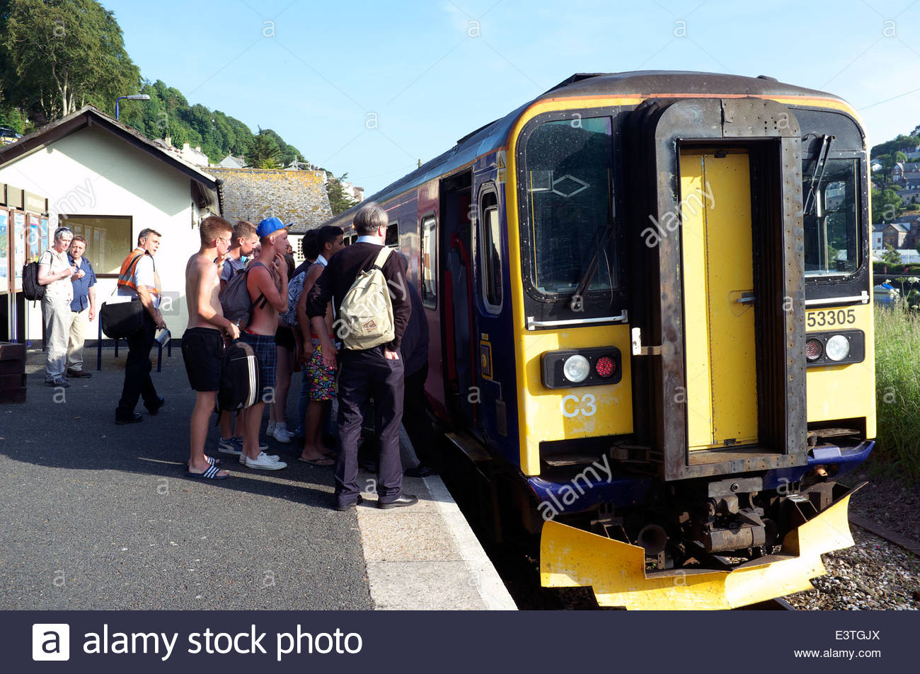 Looe Valley Line - passengers waiting to board the train at the end of the day, at Looe railway station in Cornwall, Stock Photo