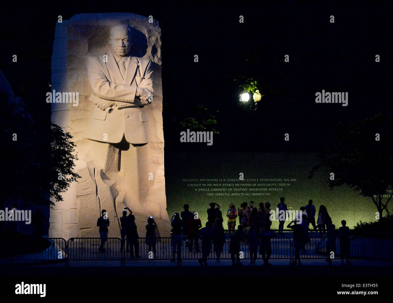 Tourists gather at night to visit the Martin Luther King Jr. Memorial June 18, 2014 in Washington, D.C. - Stock Image