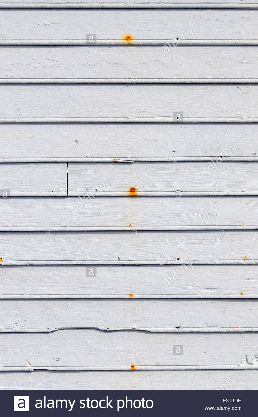 Wood planks painted in white with rusty nails - Stock Image