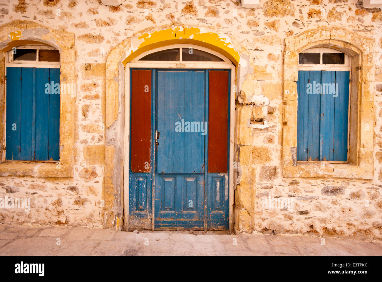 Old Rustic Blue Wooden Front Door And Blue Wooden Window Shutters On