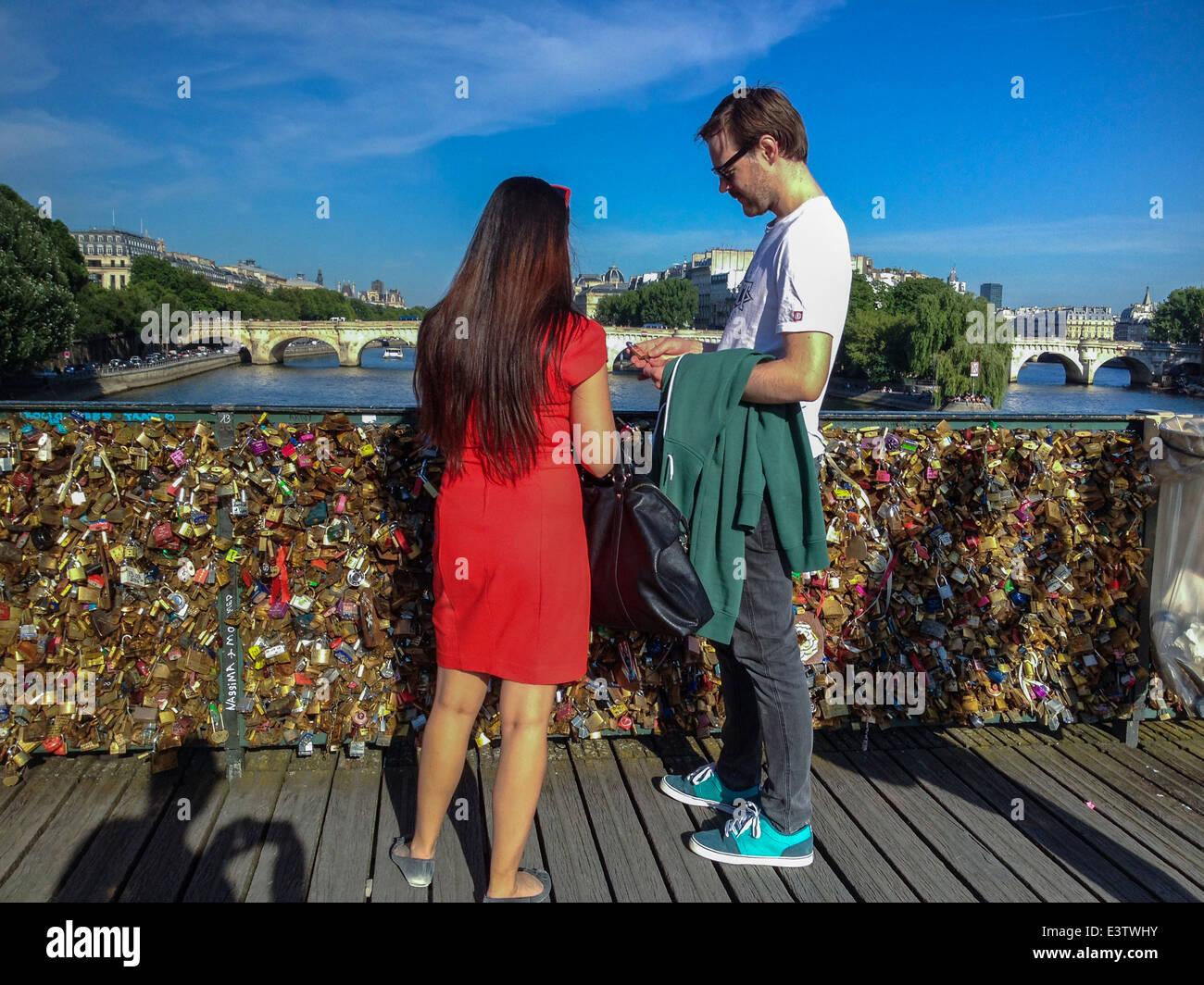 Paris, France, Tourist Couple on Seine River Bridge, 'Pont des Arts' with Love Locks, Woman Standing in - Stock Image