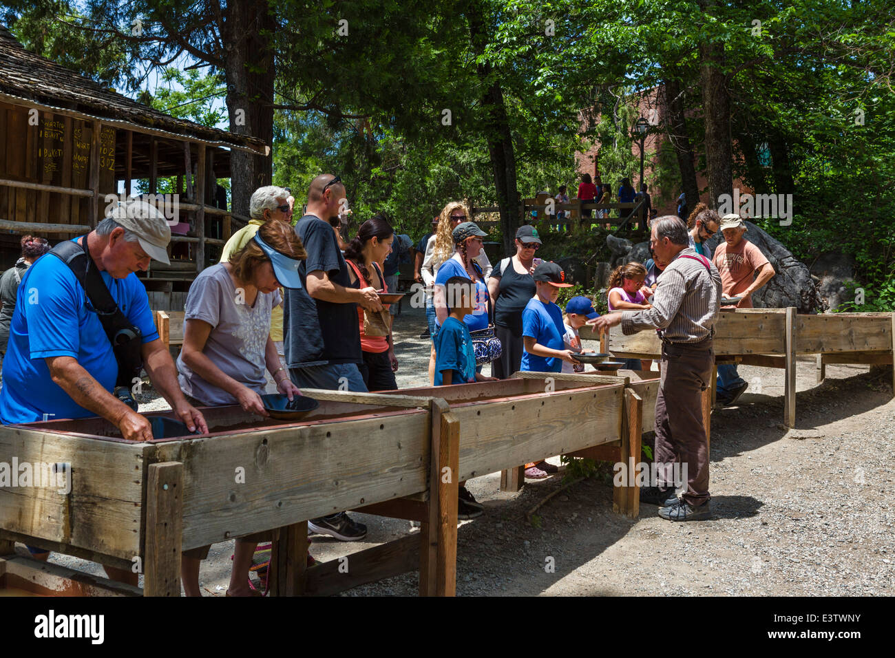 Tourists panning for gold in the old gold mining town of Columbia, Tuolumne County, Southern Gold Country, California, - Stock Image