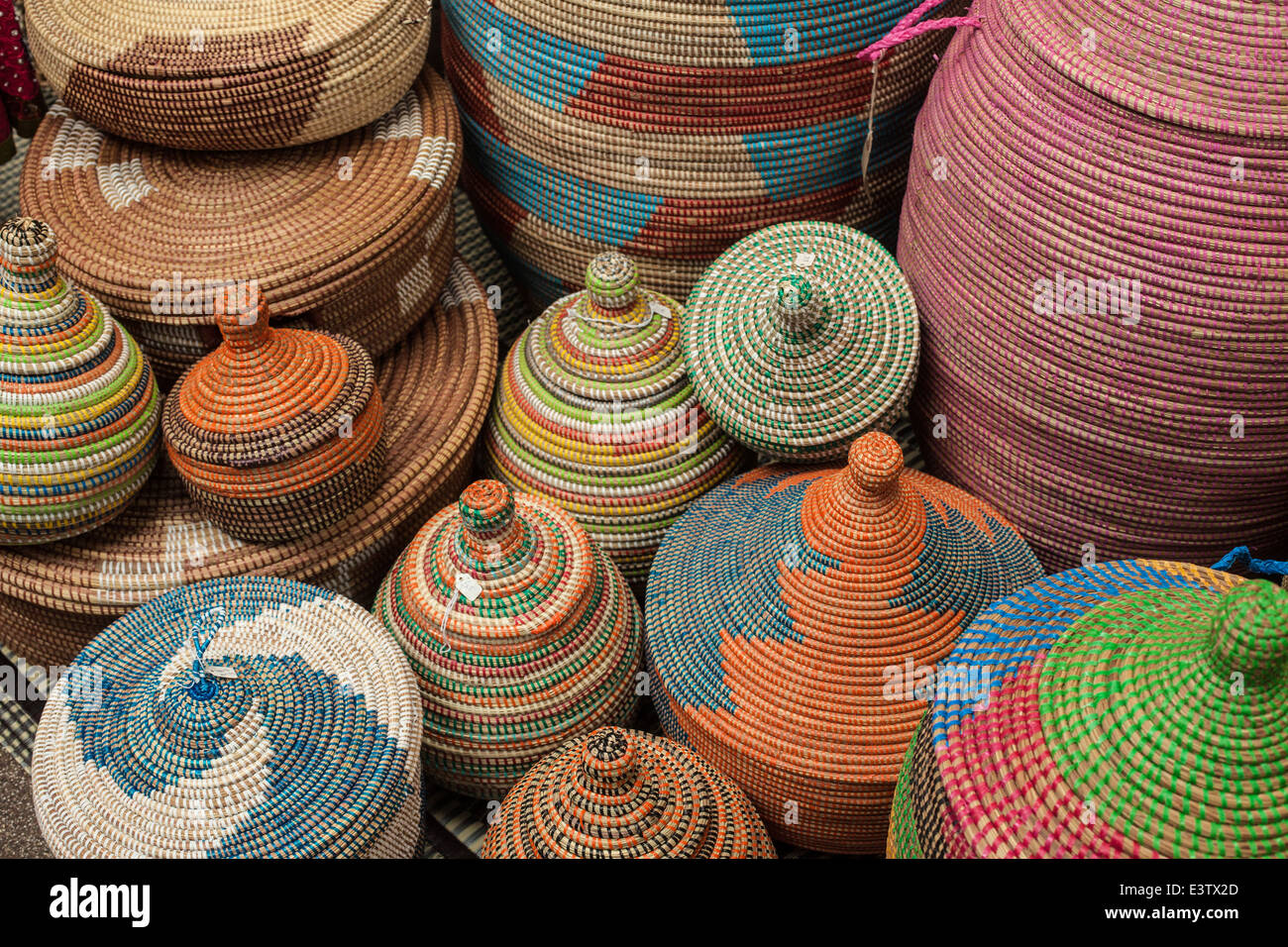 Colourful  circular,multicoloured baskets different sizes in market - Stock Image