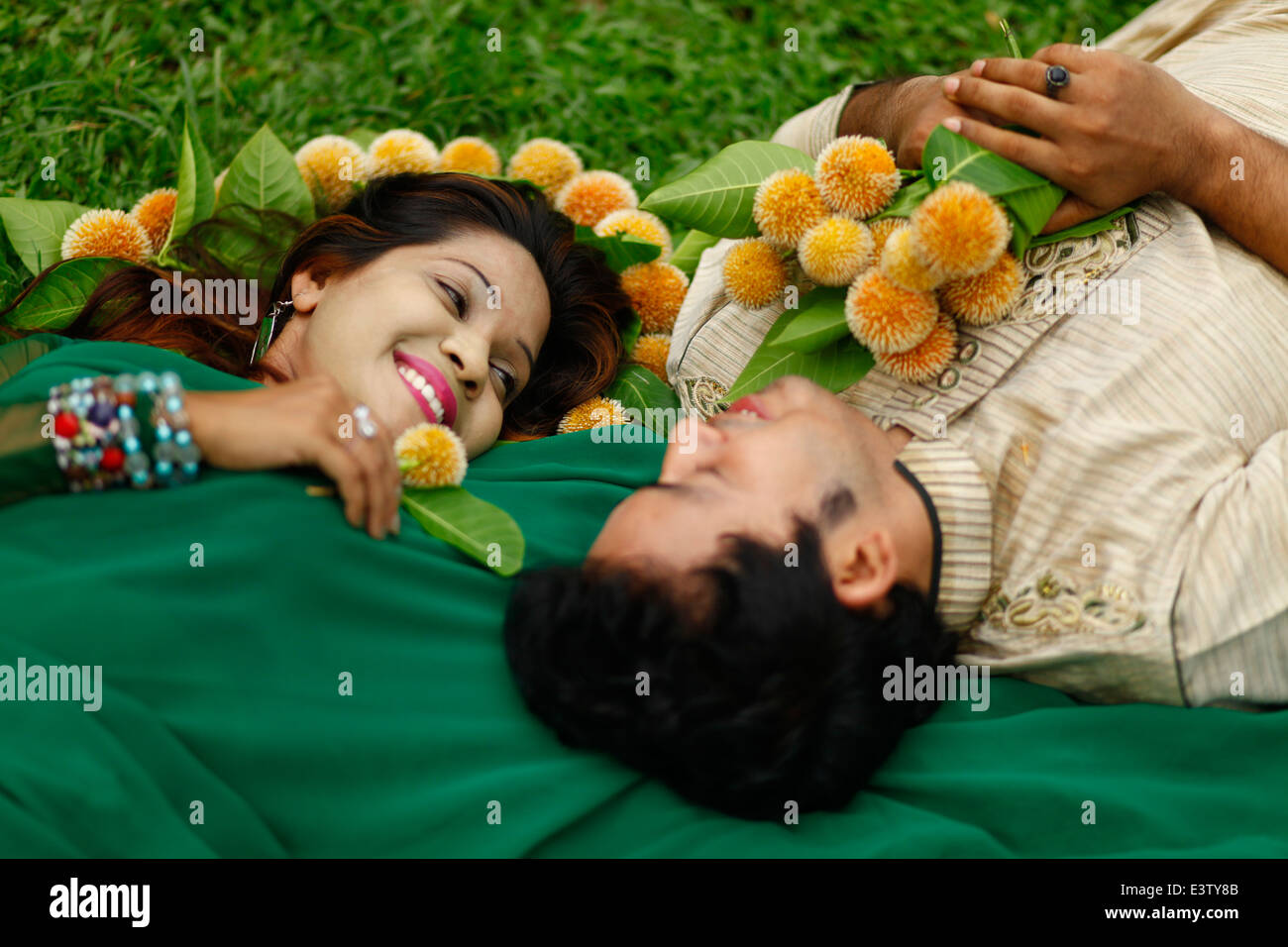 A couple present their love with kadam flowers the kadam flower anthocephalus cadamba