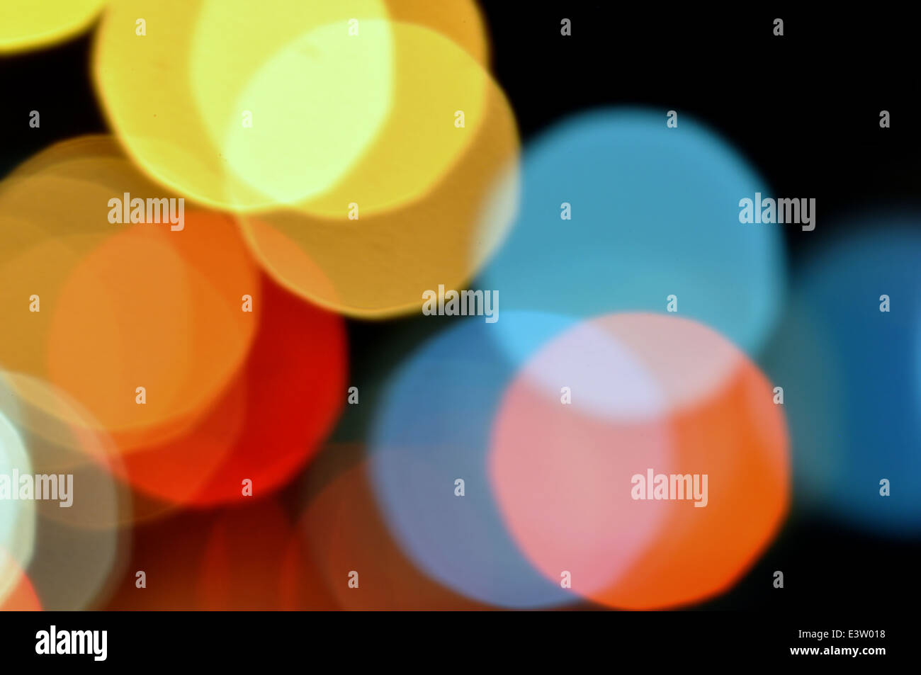Abstract blurry lights at night colorful circles background. Stock Photo
