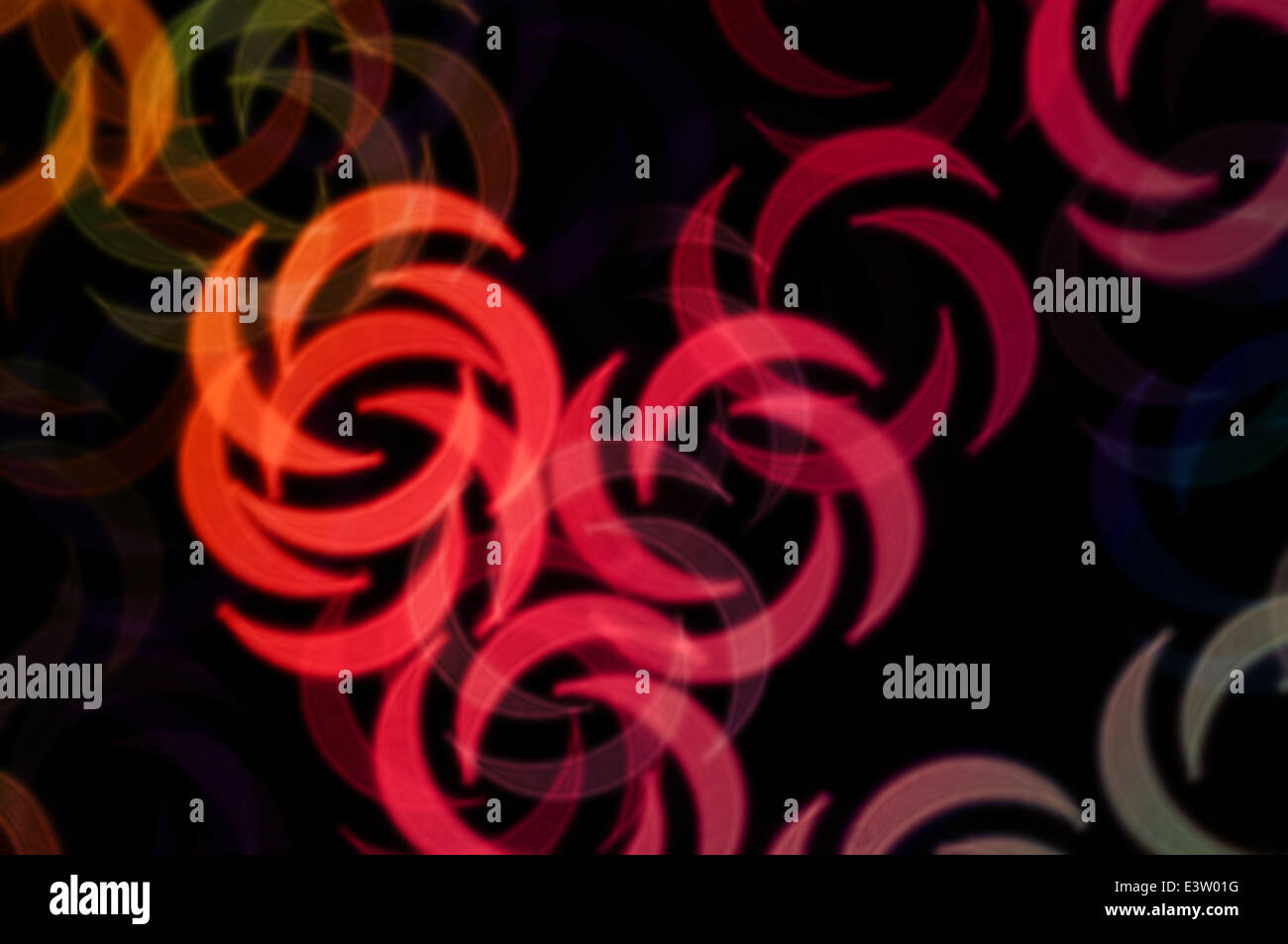 Abstract swirl shapes colorful orbs blur party background. Stock Photo
