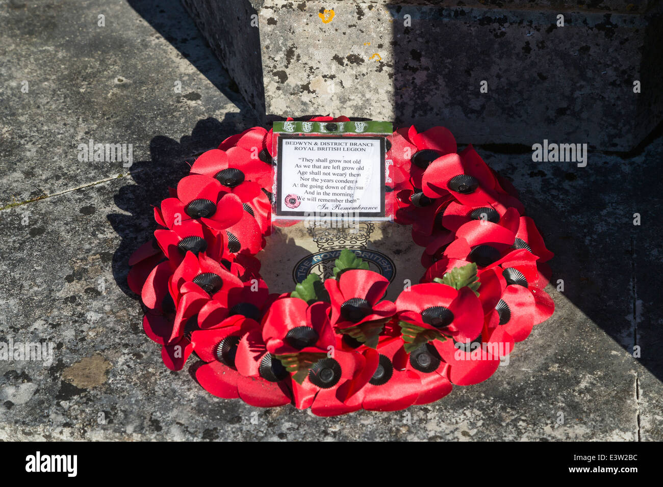 Red poppy Royal British Legion Remembrance Day wreath at Great Bedwyn church, Wiltshire, UK - Stock Image