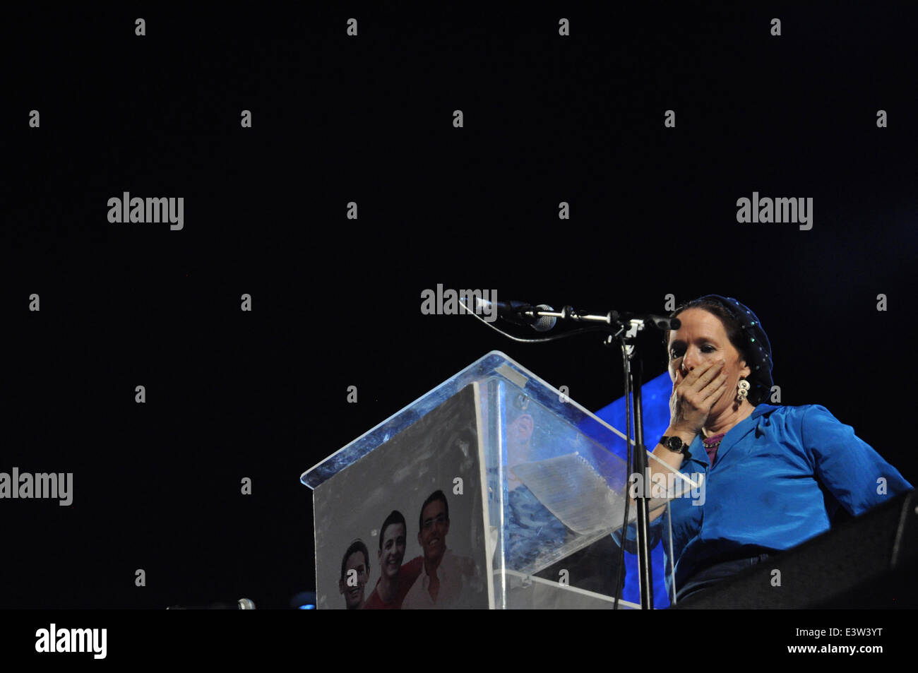 TEL AVIV, ISRAEL - June 29. The mother of one of the kidnapped boys has a moment of commotion on stage during a - Stock Image