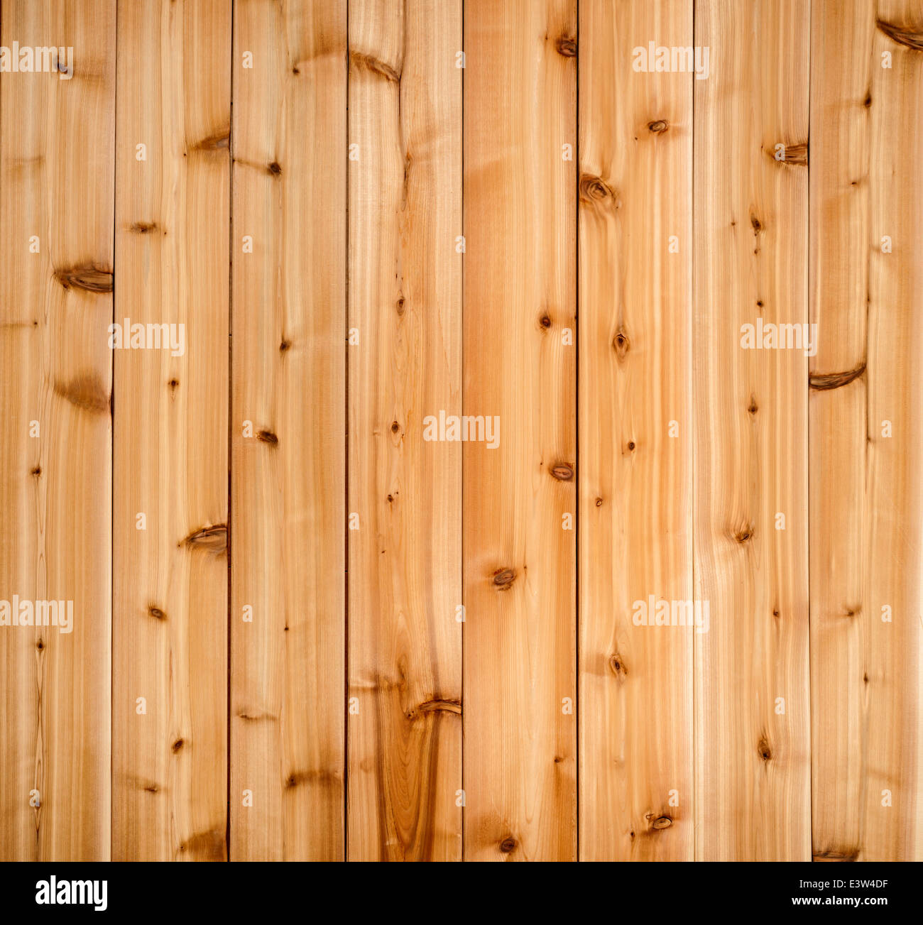 Background of wooden red cedar planks showing woodgrain texture - Stock Image