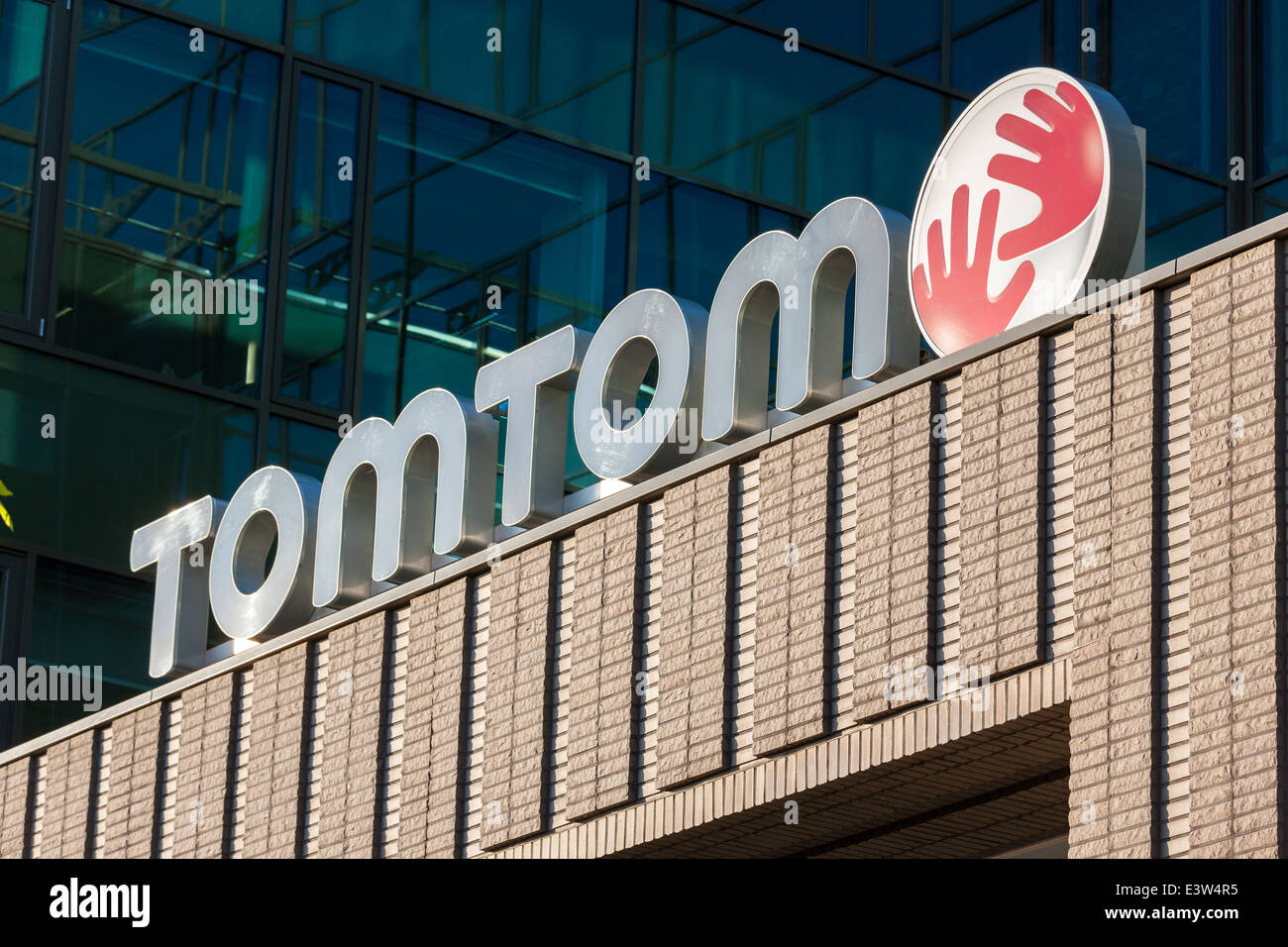 TomTom Logo Dutch automotive navigation systems manufacturer Entrance of Amsterdam HQ headquarters head office DRK - Stock Image