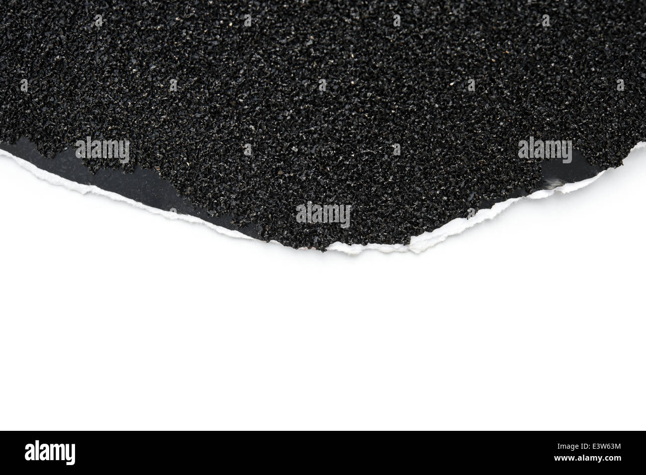 rough sand paper on white with copy space - Stock Image