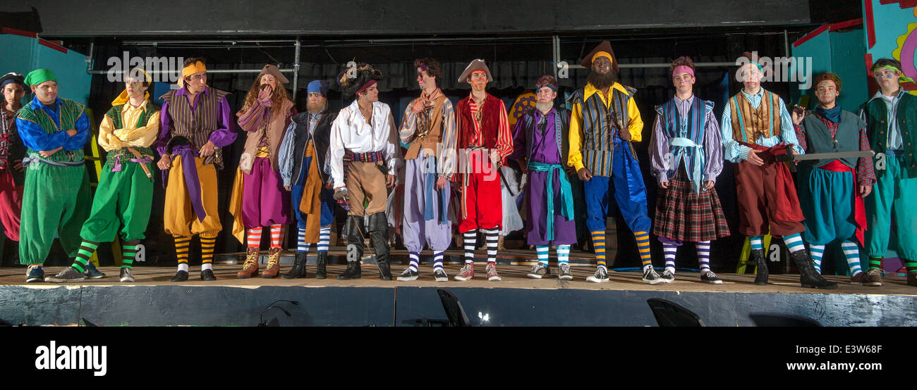 The male cast members line up on the stage for a dress rehearsal of a high school production of Gilbert & Sullivan's - Stock Image