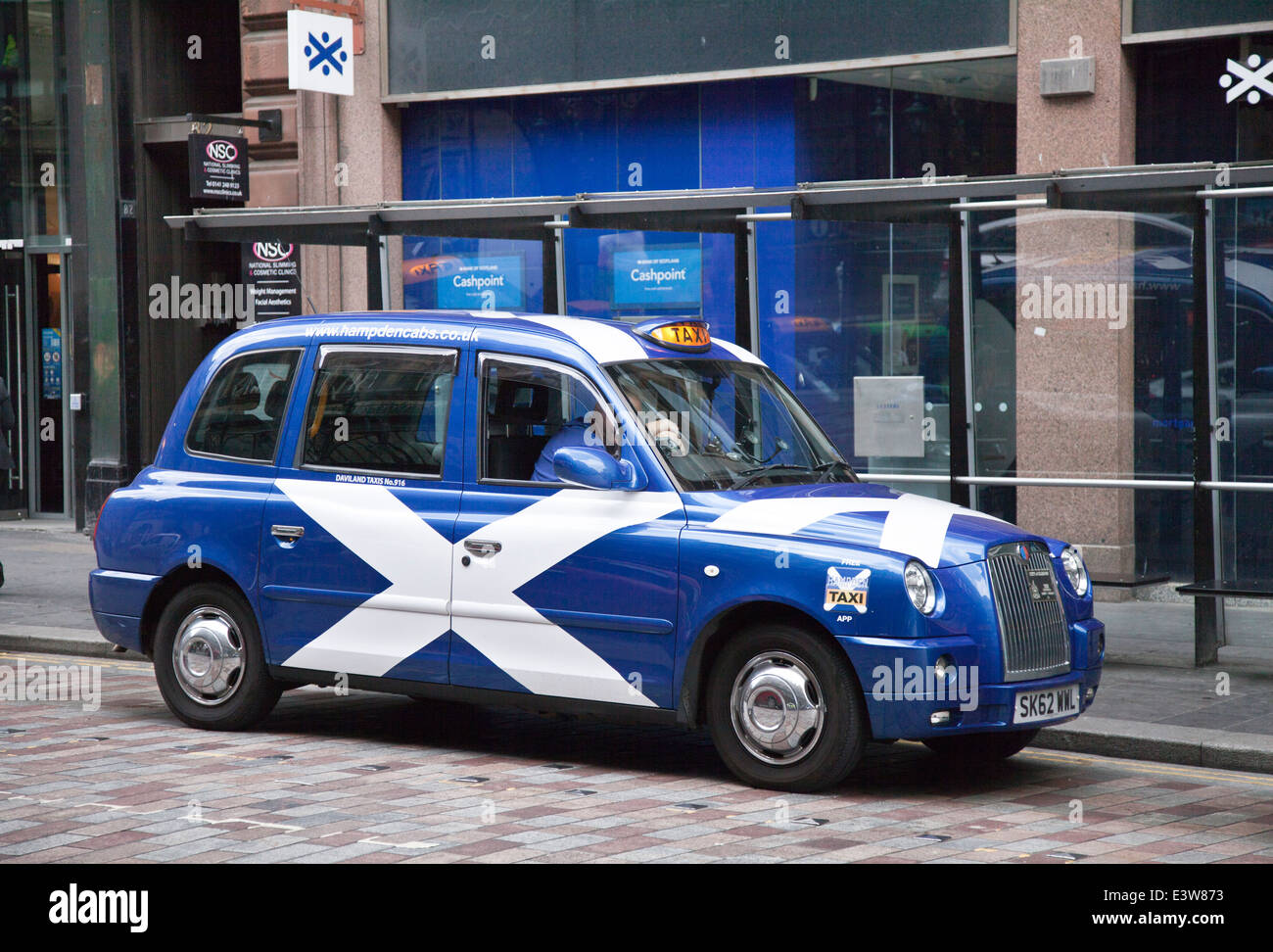 Blue & White Taxis in Glasgow with the livery of the Scottish National Flag.  A saltire or Saint Andrew's - Stock Image