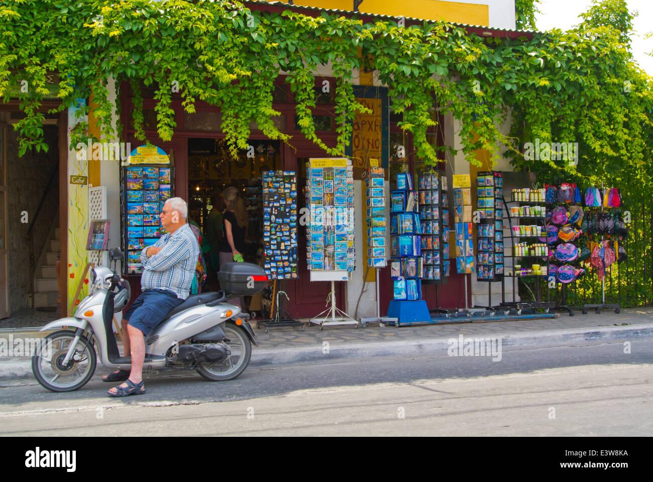 Local man on scooter outside souvenir shop, Logotheti street, Pythagoreio, Samos, Greece, Europe Stock Photo