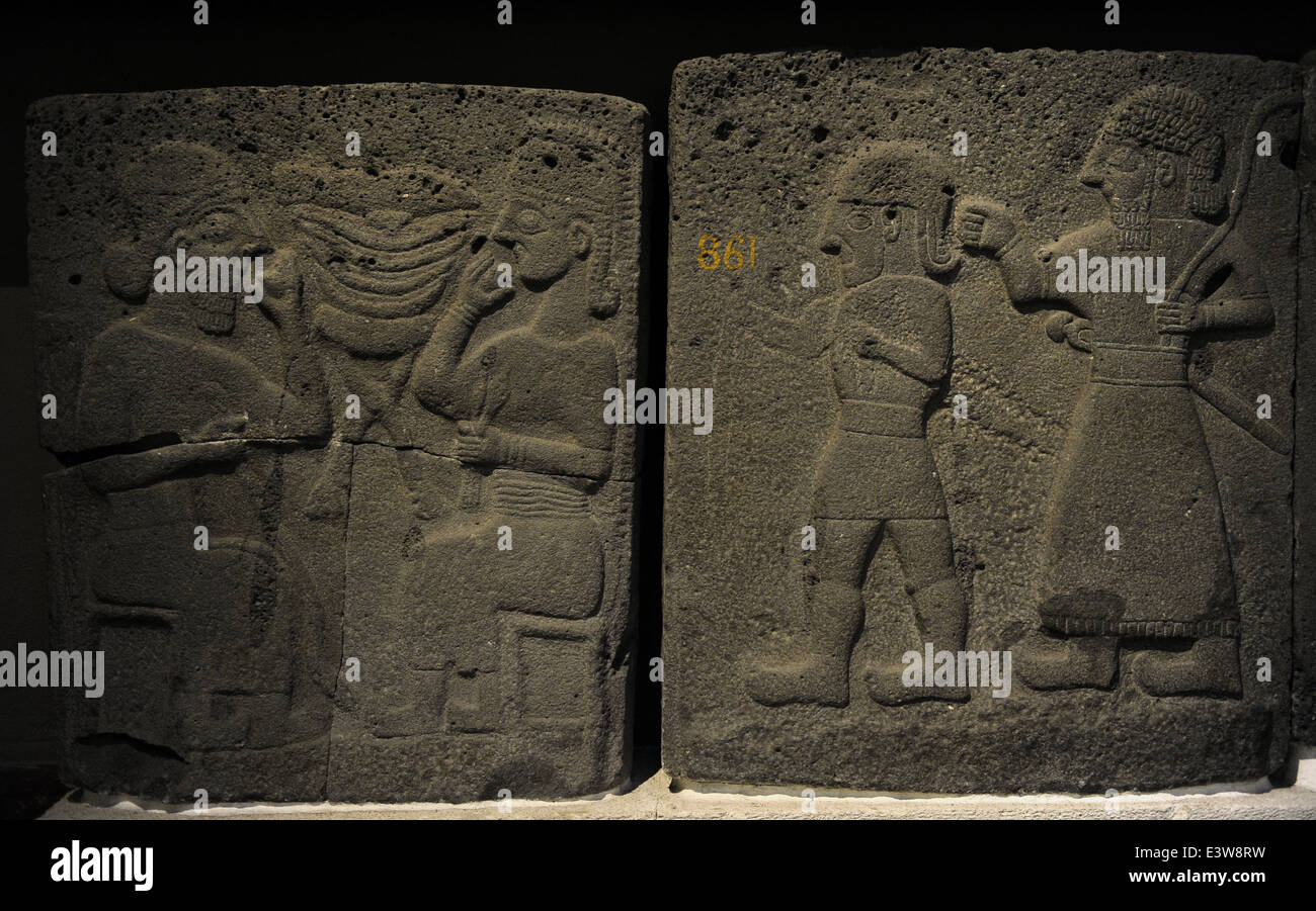 Orthostat with relief depicting a banquet (left) and males walking (right). 9th century BC. Basalt. Late Hitite Stock Photo