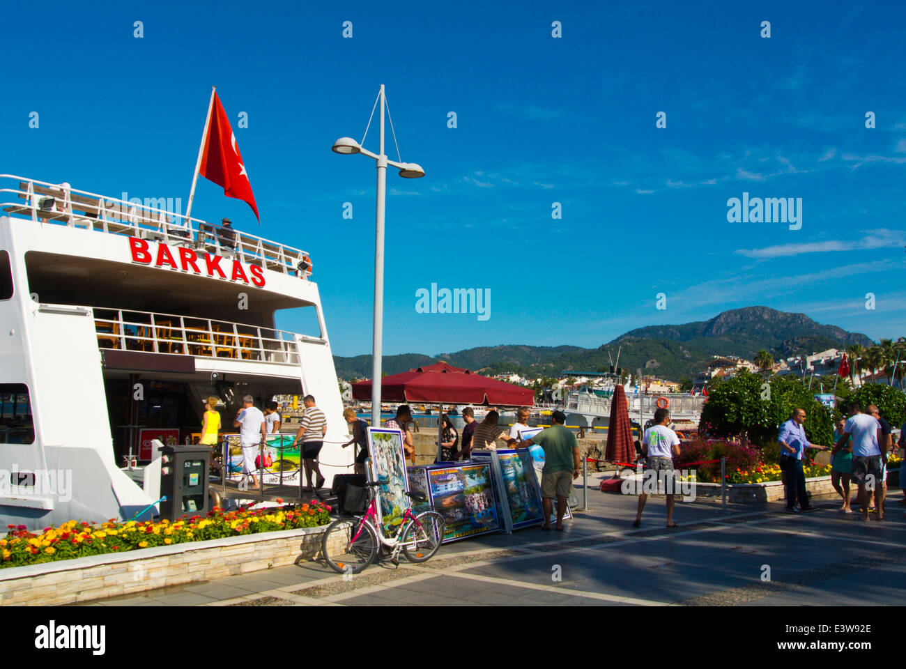 People getting on cruise boat in the morning, Kordon street, the harbour, Marmaris, Mugla province, Turkey, Asia - Stock Image
