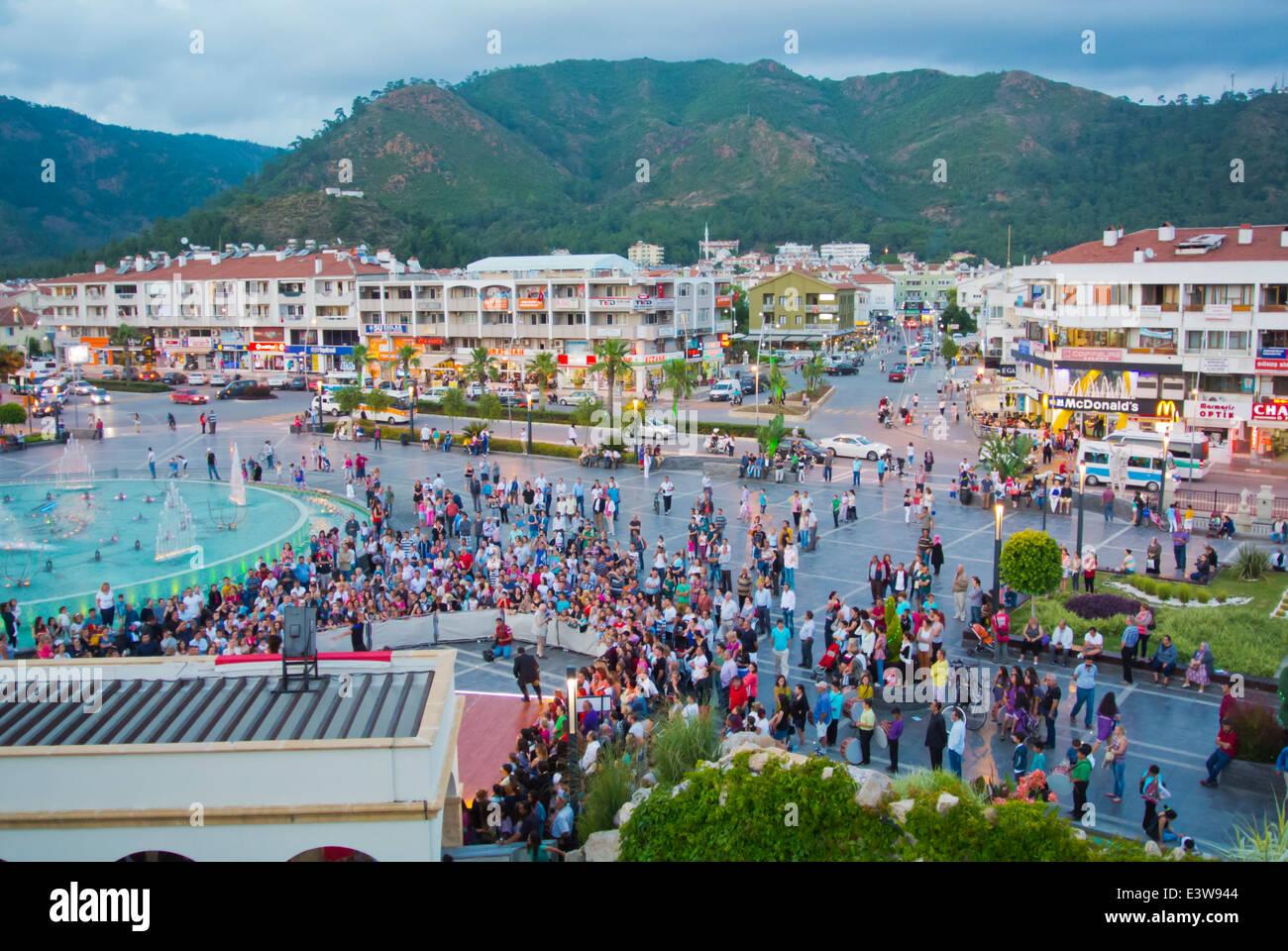 Crowds during evening show, 19 Mayis Genclik Meydani, 19th May Youth Square, main square, Marmaris, Mugla province, - Stock Image