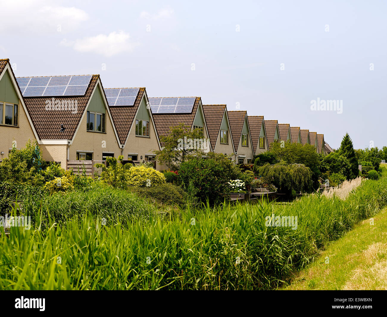 Generating solar energy by placing solar panels on houses, Netherlands 2014 - Stock Image
