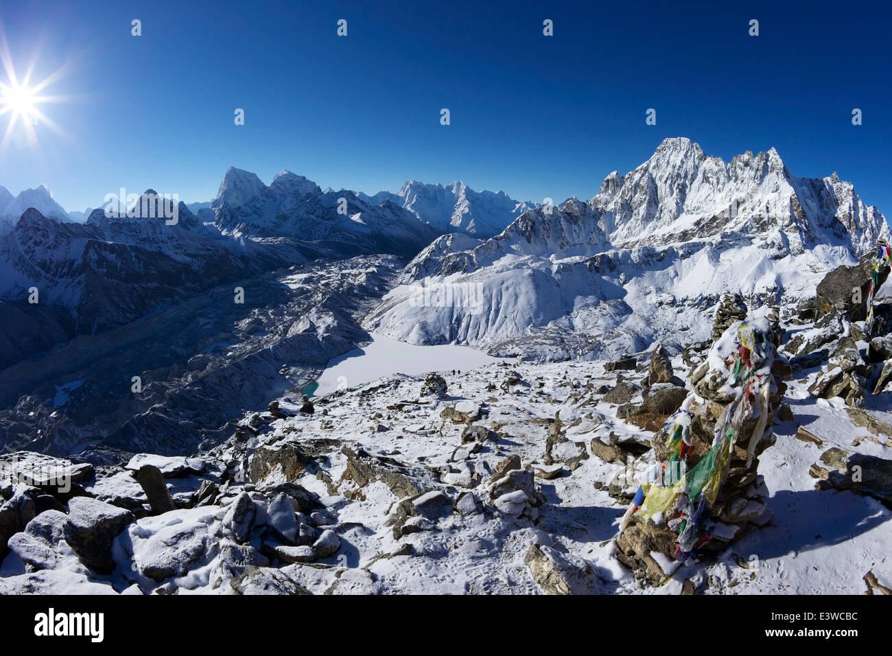 Sunrise over Mount Everest from Gokyo Ri, with Ngozumba Glacier and frozen Dudh Pokhari, Solukhumbu District, Nepal - Stock Image