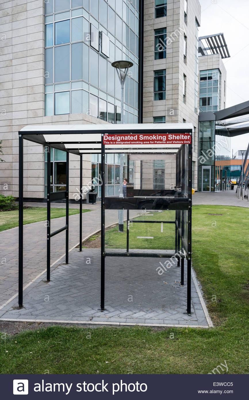 Designated Smoking Shelter outside Peterborough City Hospital, Cambridgeshire, England, UK - Stock Image