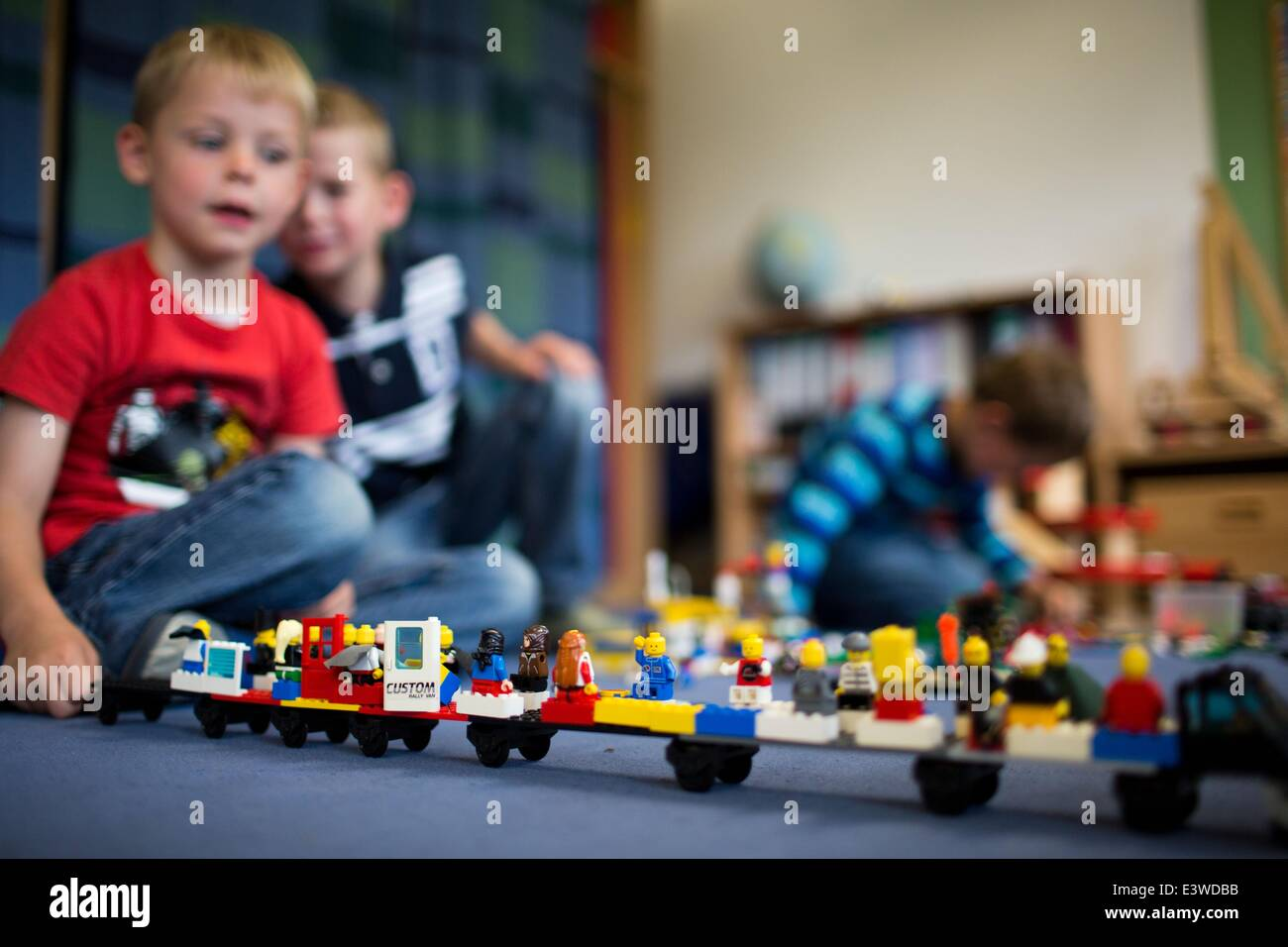 Wismar, Germany. 19th June, 2014. Julien plays with his friends in one of the group rooms of the integrated nursery Stock Photo