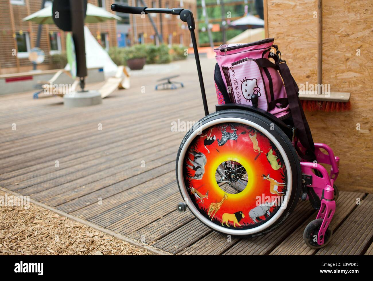 Wismar, Germany. 19th June, 2014. A childrens' wheelchair stands near the exit door to the garden of the integrated Stock Photo