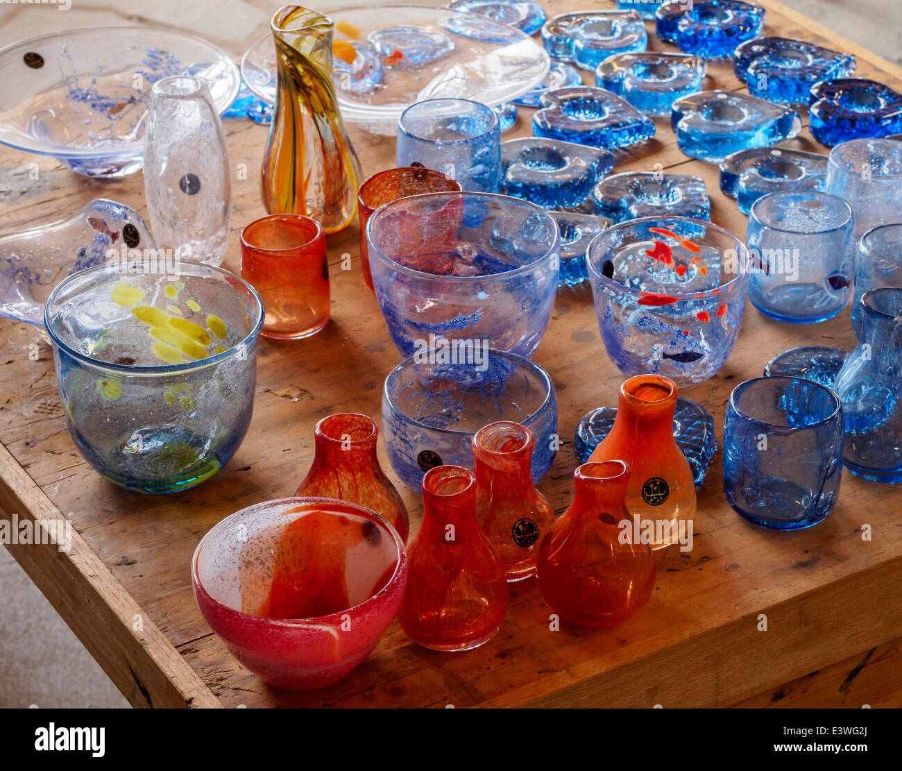 Artisan glass products made in the Glass Factory Vikten on the Lofoten islands are offered for sale. - Stock Image