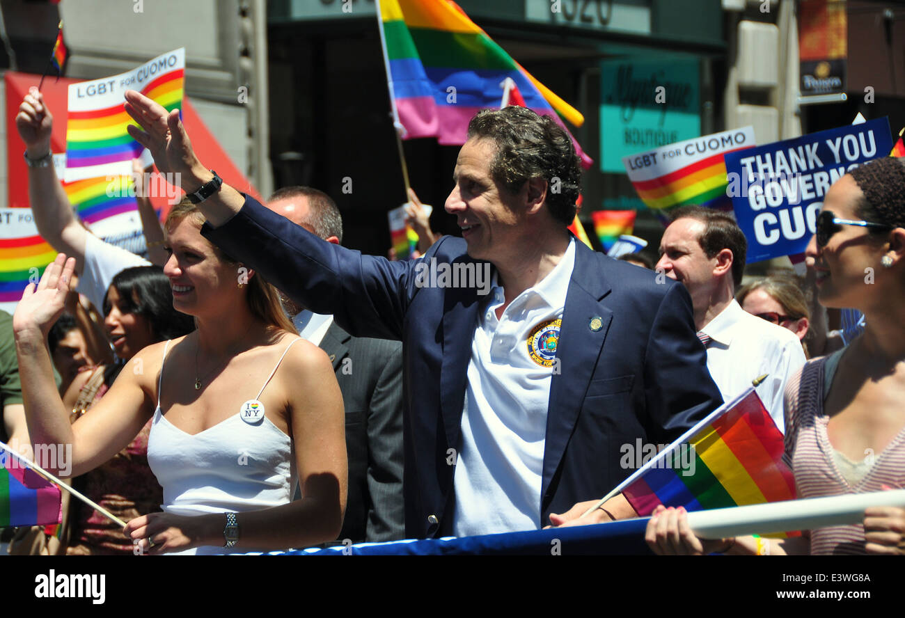 NYC: New York Governor Andrew Cuomo waves to the crowd while marching at the 2014 Gay Pride Parade on Fifth Avenue - Stock Image