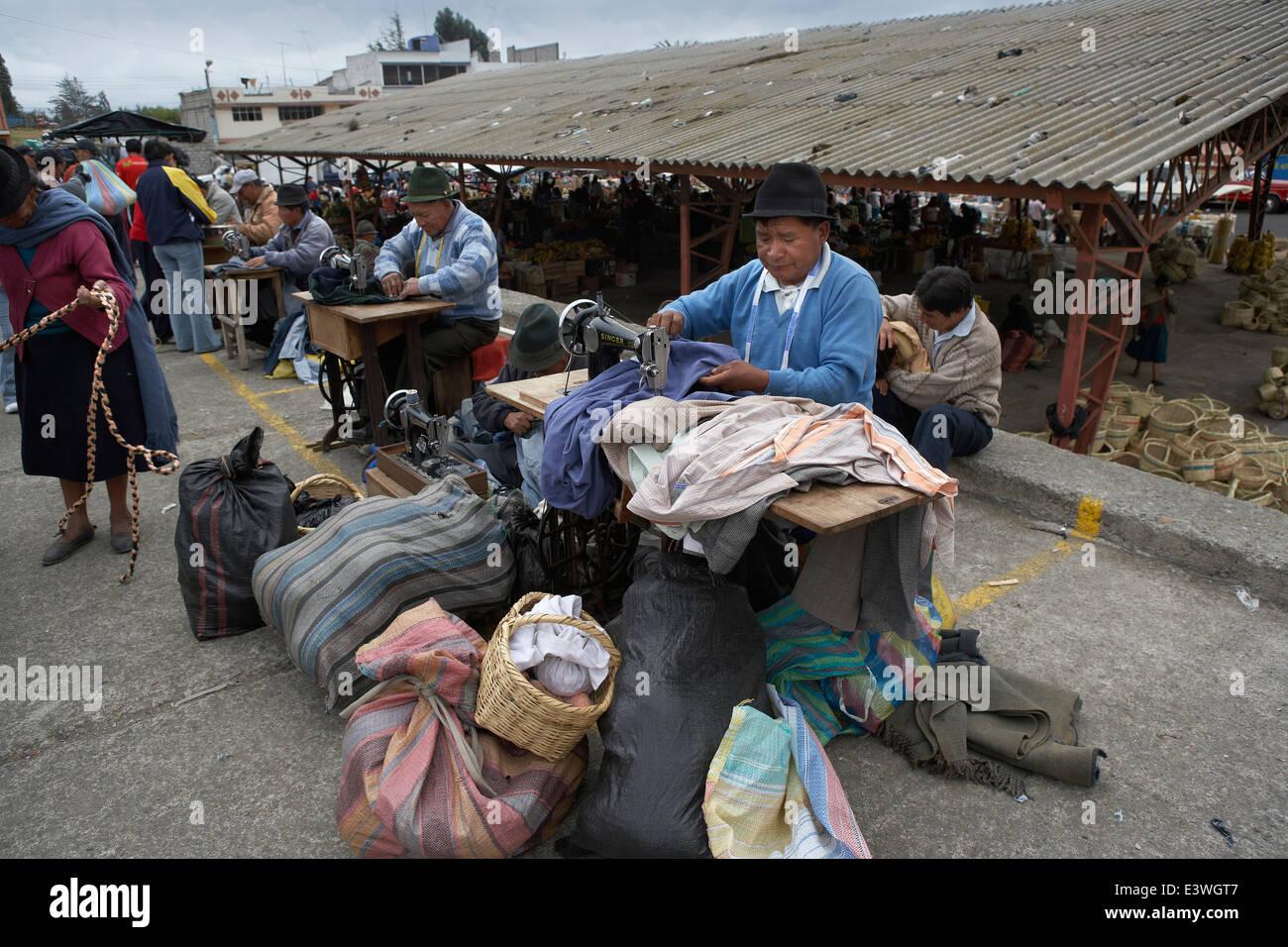Men sewing clohes on the streets, Saquisili Market, Ecuador - Stock Image