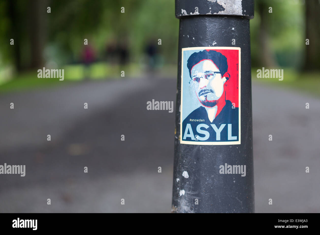 A poster calling for Edward Snowden to be given asylum - Stock Image