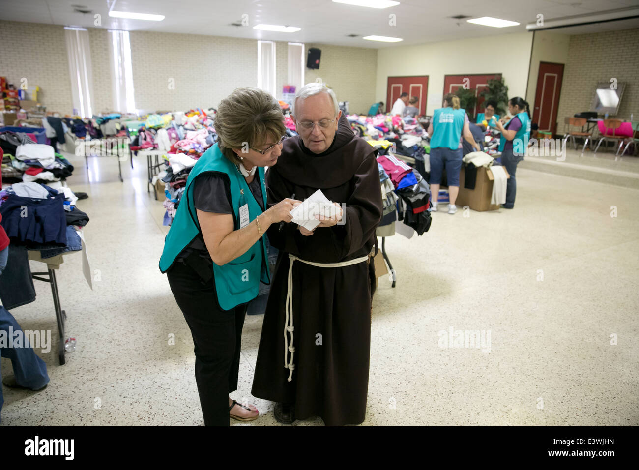 volunteers at Catholic Charity shelter in McAllen, Texas. Surge of immigrants from Central America crossed  Texas - Stock Image