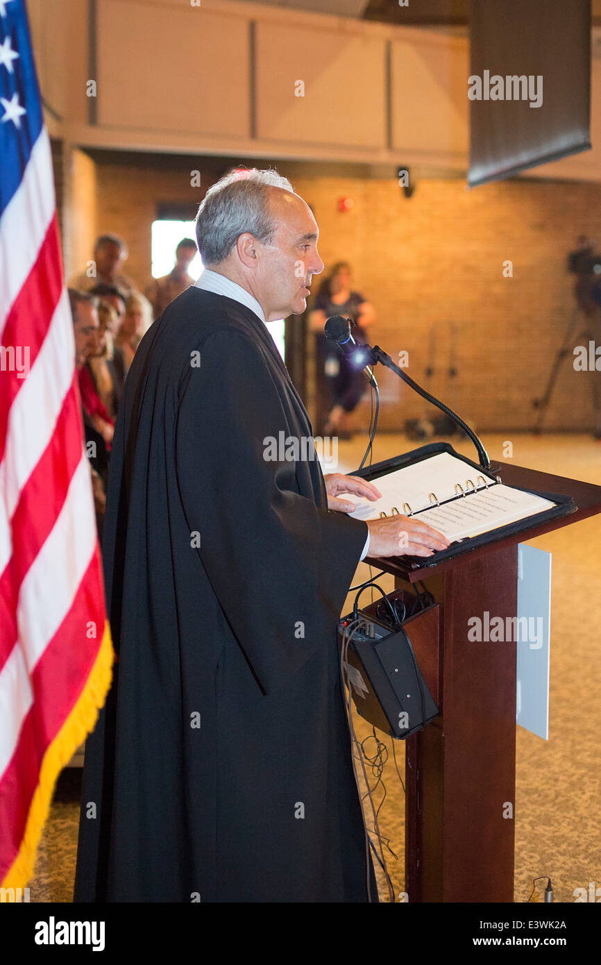 Judge George Caram Steeh, a federal judge from the Eastern District of Michigan, presides over a naturalization - Stock Image