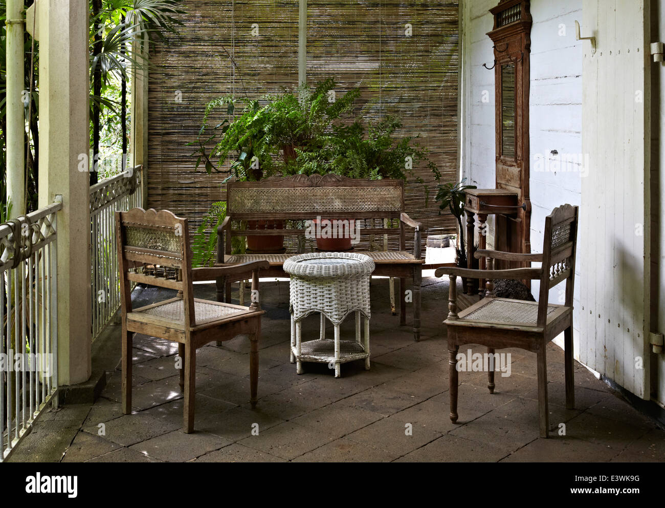 Table and chairs on veranda of la maison creole a french colonial house also known as eureka or house of 109 doors in moka