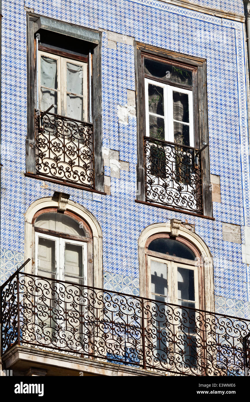Ceramic azulejos tiles on the facade of a house in the historical centre of Coimbra, Beira Litoral, Portugal - Stock Image
