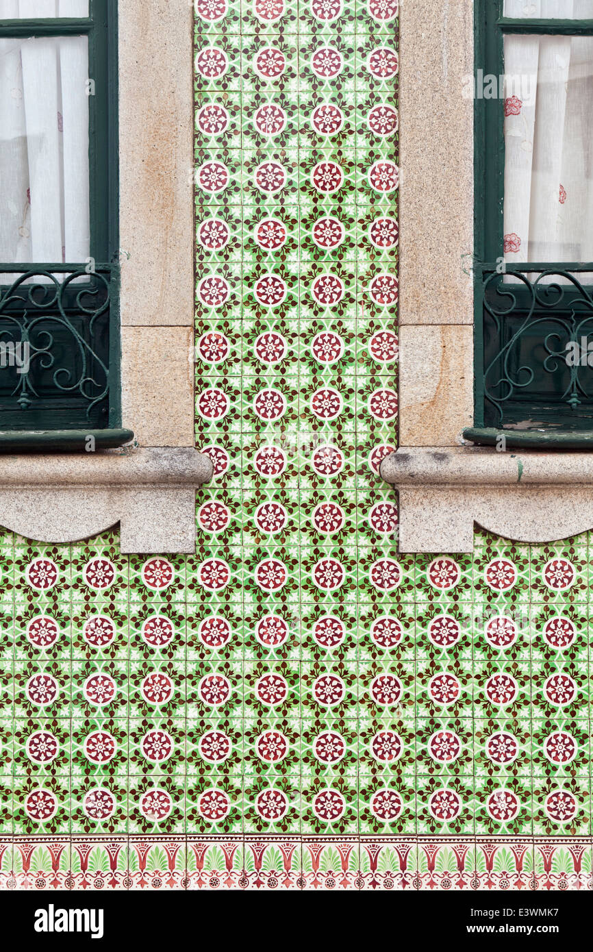 Traditional ceramic azulejos tiles decorate the facade of a house in Ovar, Beira Litoral, Portugal - Stock Image