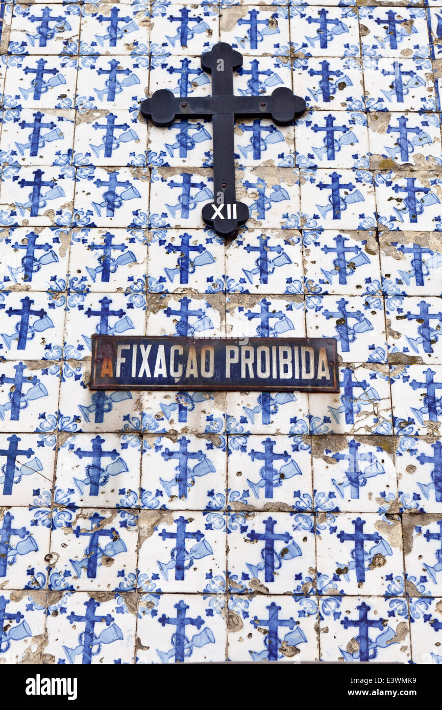 Painted ceramic azulejos tiles and crucifix decorate the facade of a church in Ovar, Beira Litoral, Portugal - Stock Image