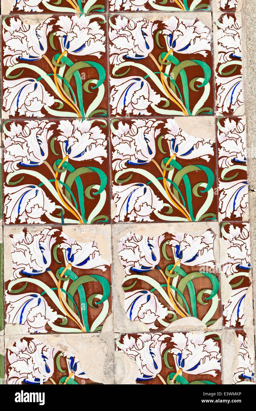 An example of floral motifs painted on traditional ceramic azulejos tiles, Ilhavo, Beira Litoral, Portugal - Stock Image