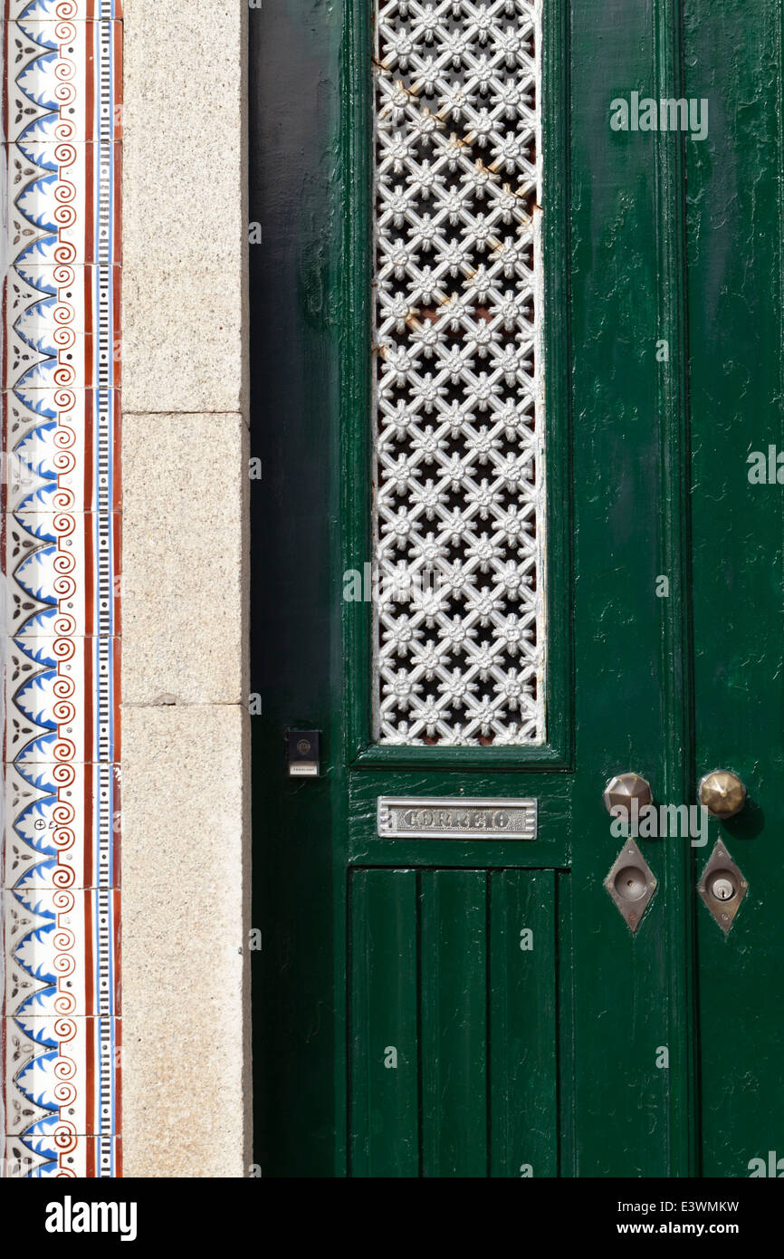 Azulejos tiles provide a decorative edge to a traditional doorway in Ilhavo, Beiras Litoral, Portugal - Stock Image