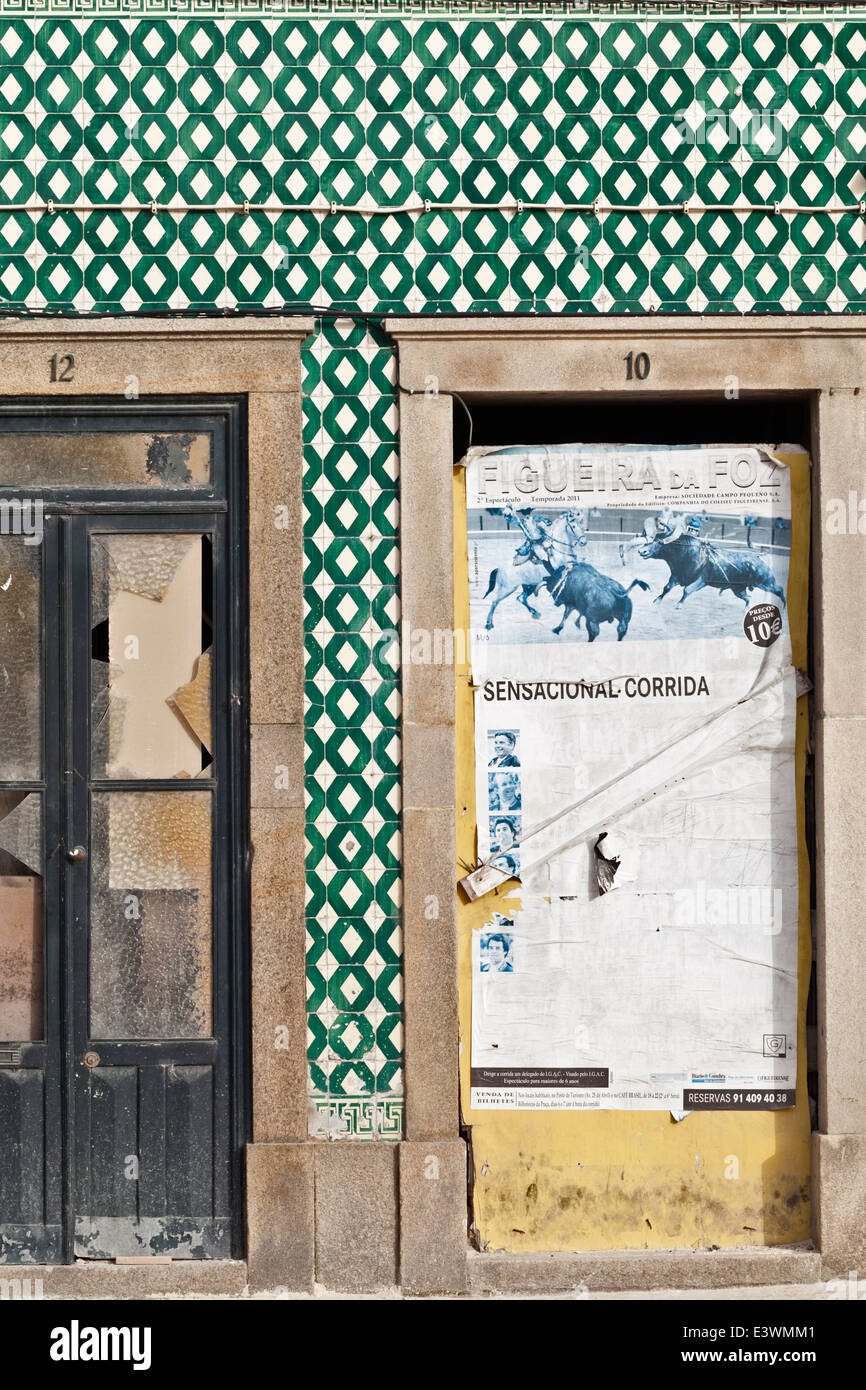 Traditional Azulejos tiles surround old doorways in Ilhavo, Aveiro, Portugal - Stock Image