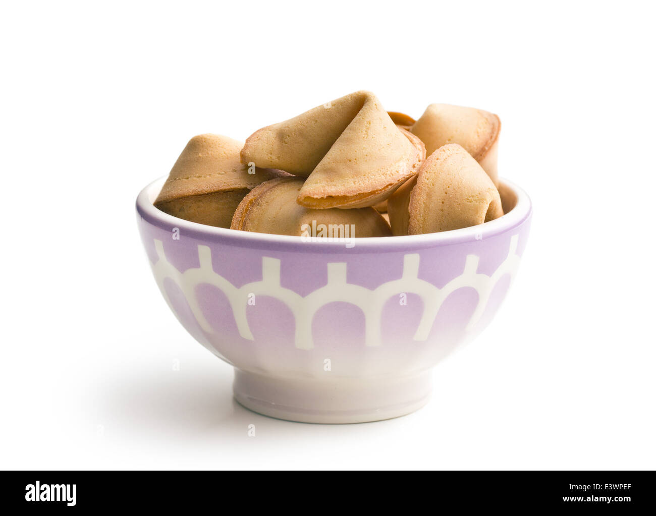 fortune cookie in ceramic bowl - Stock Image