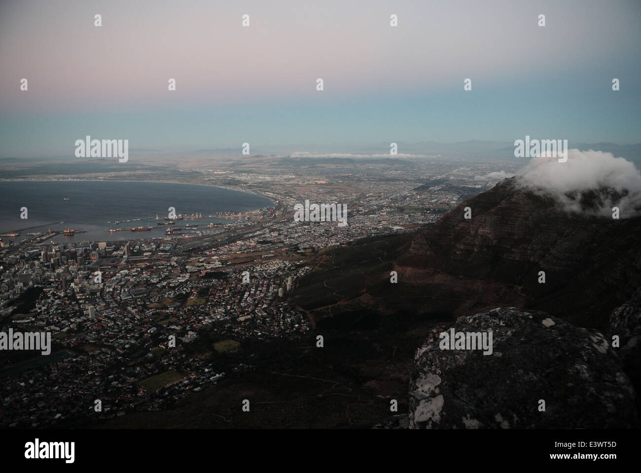 Aerial view at dusk of Cape Town, Devil's Peak and False Bay from the top of Table Mountain - Stock Image
