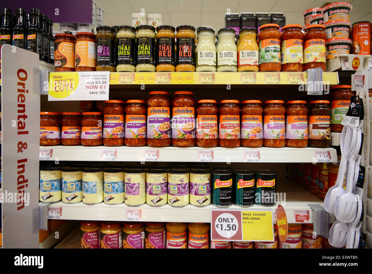 Oriental And Indian Foods On A Supermarket Shelf Stock Photo
