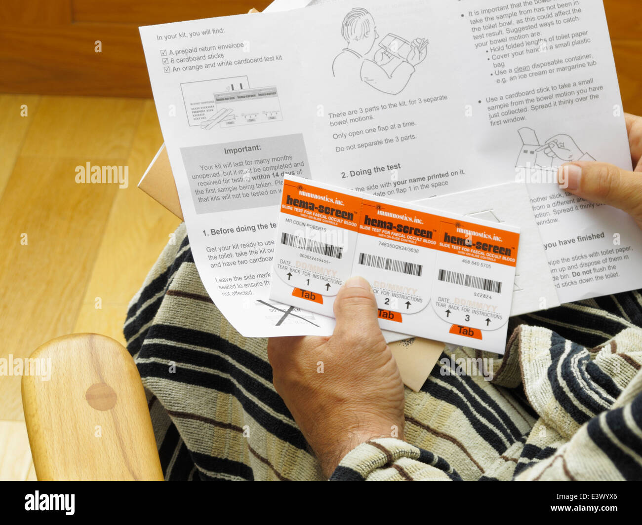 Slide test for faecal occult blood mass screening for bowel cancer in UK.  senior over 60s man reading instructions Stock Photo