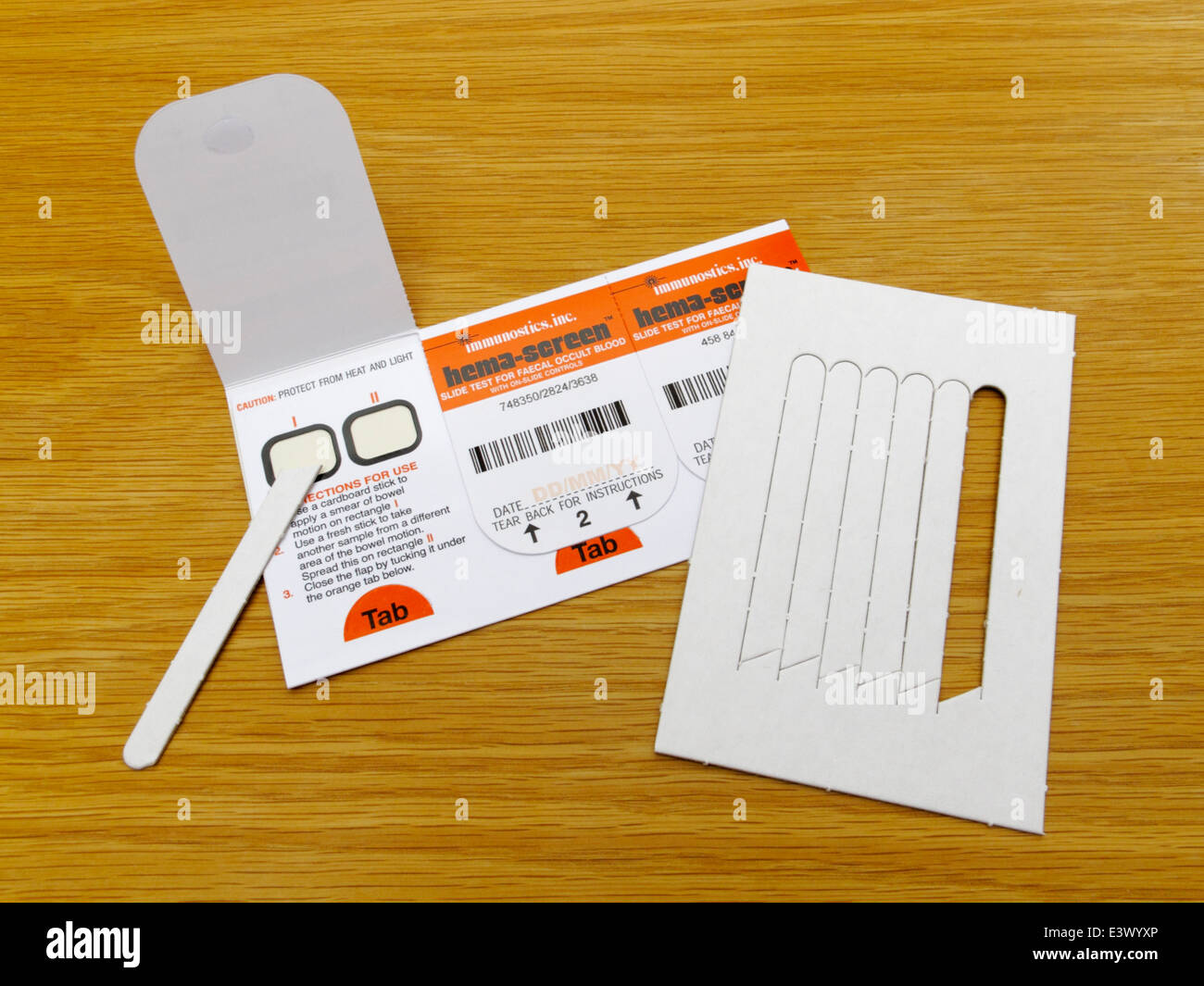Slide test for faecal occult blood mass screening for bowel cancer in UK. Operated by immunostics inc hema-screen Stock Photo