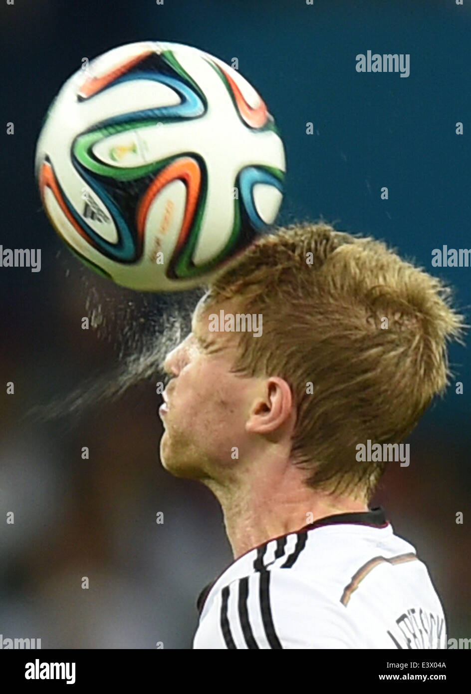 Porto Alegre, Brazil. 30th June, 2014. Germany's Per Mertesacker heads the ball during a Round of 16 match between Stock Photo