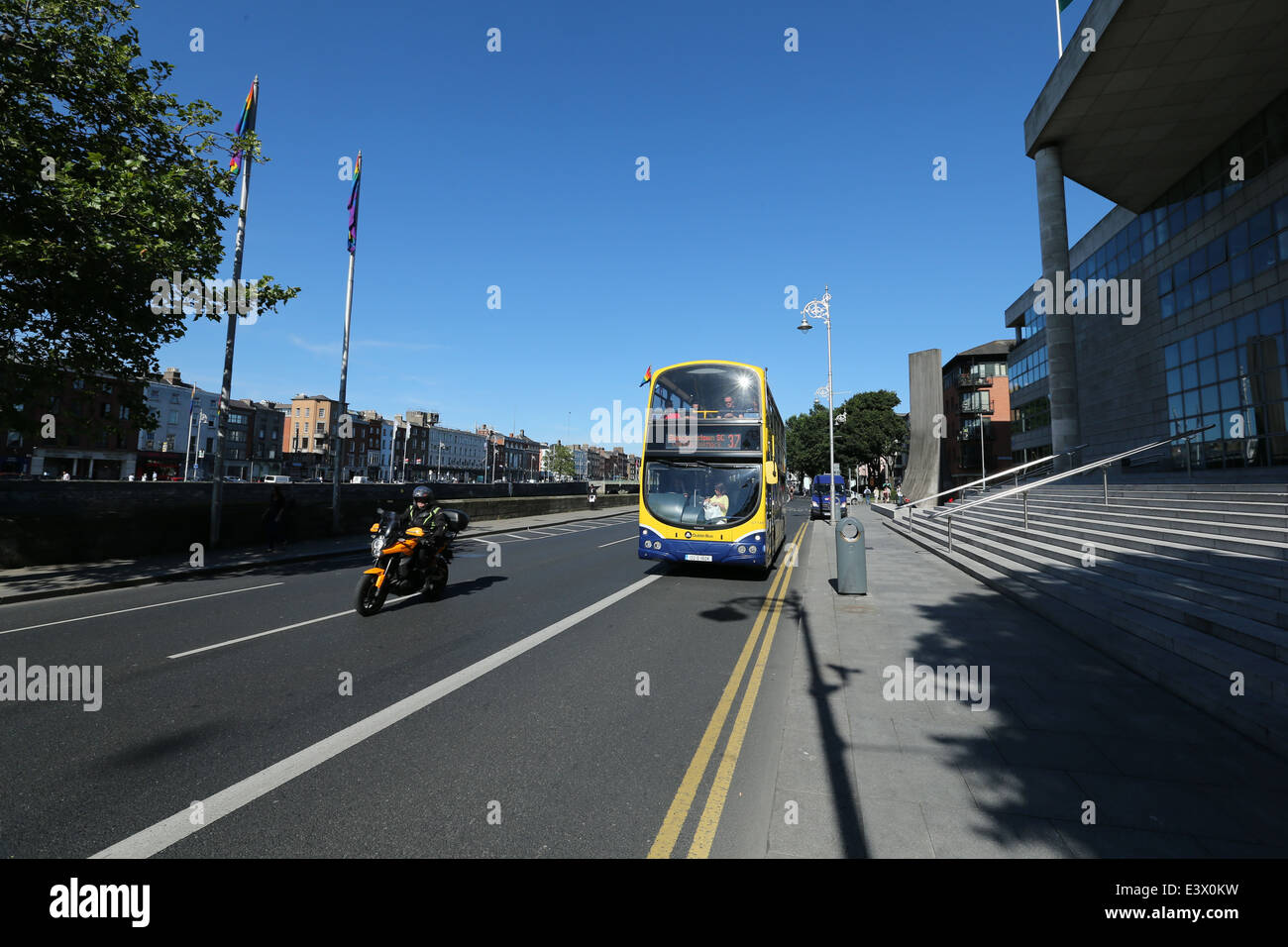 Traffic including a Dublin Bus vehicle on a road at Wood Quay along the River Liffey in Dublin during a period of - Stock Image