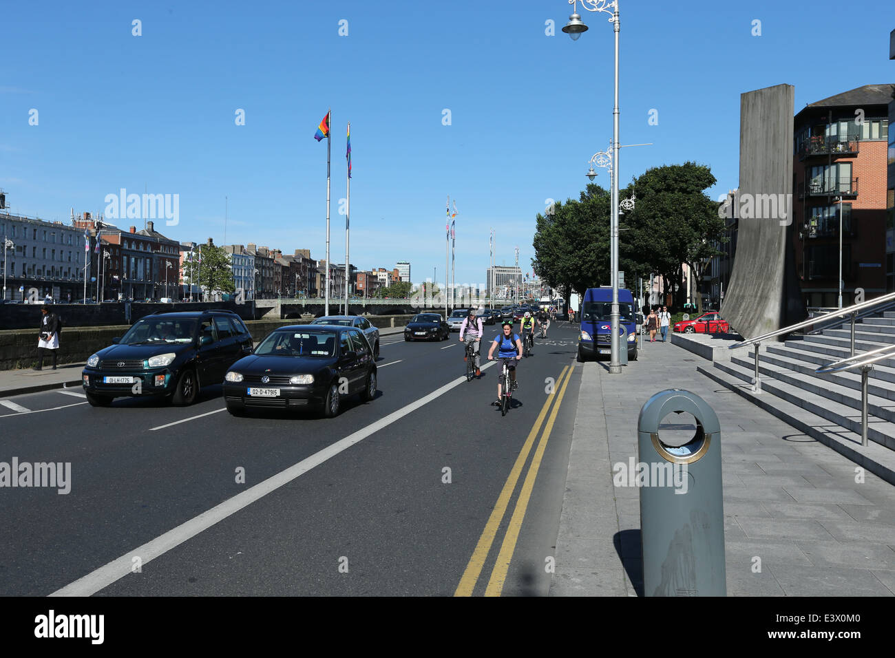 Traffic on a road at Wood Quay along the River Liffey in Dublin during a period of good weather - Stock Image